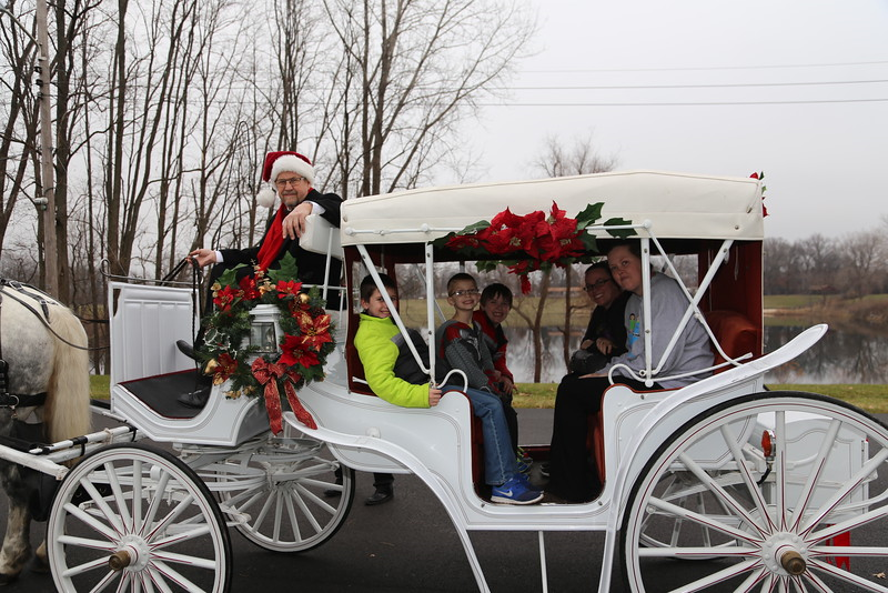 The horse and carriage rides are shown at the Burns Harbor Park Department'a Santa Dash.